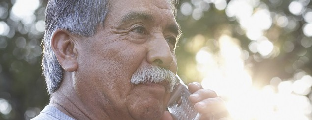 Side profile of a mature man using a mobile phone